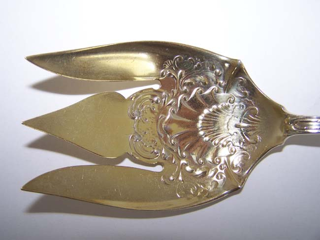 click to view larger image of A Late 19th or early 20th century American Sterling Silver Serving Fork