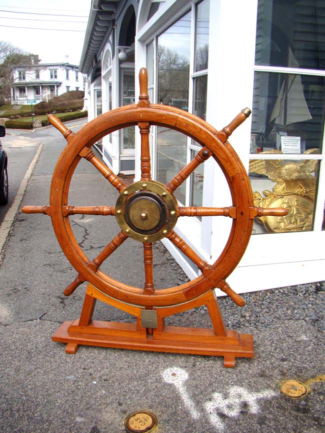 click to view larger image of A fine and large 19th century teak wood ship's wheel from the Dutch ship 'Weiner'