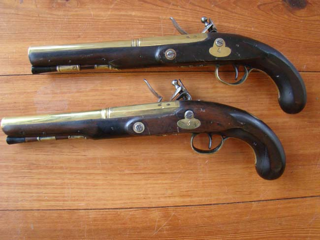 click to view larger image of A pair of English flintlock brass barreled coaching pistols by John Bennett circa 1790