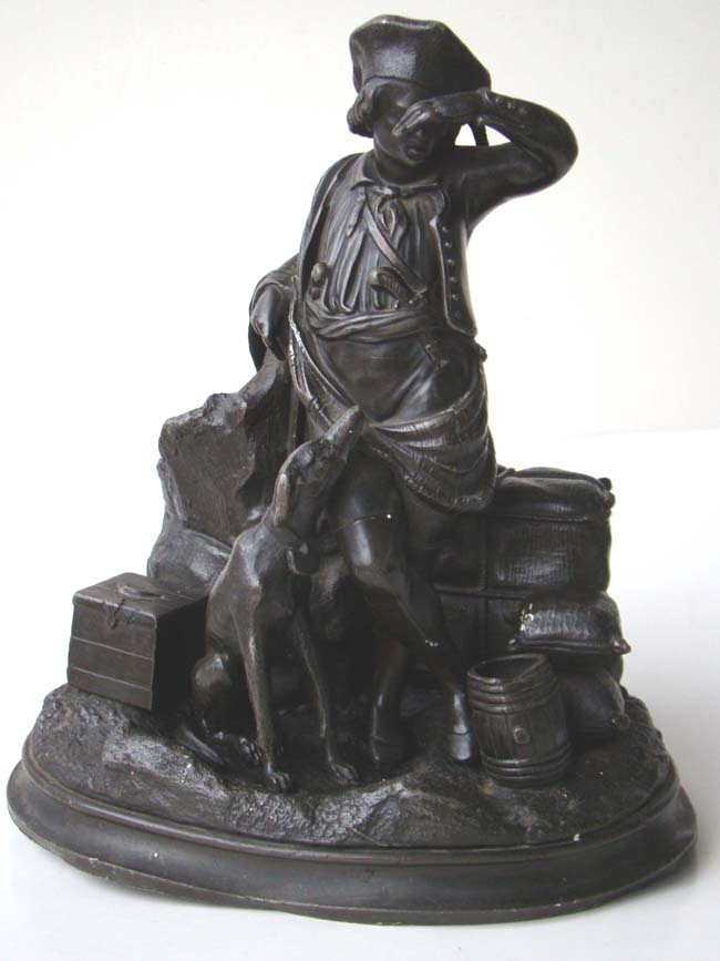 click to view larger image of  An antique inkwell depicting a sailor with his dog on a wharf circa 1860