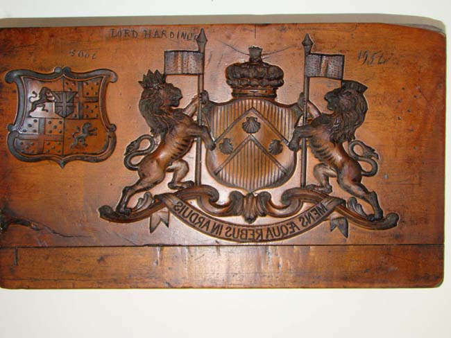 click to view larger image of An 18th century incised carved fruitwood composition mold bearing the arms and crest of the Berkeley family dated 1754.