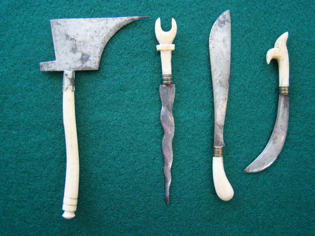 click to view larger image of A group of four 19th century miniature steel bladed weapons with bone handles