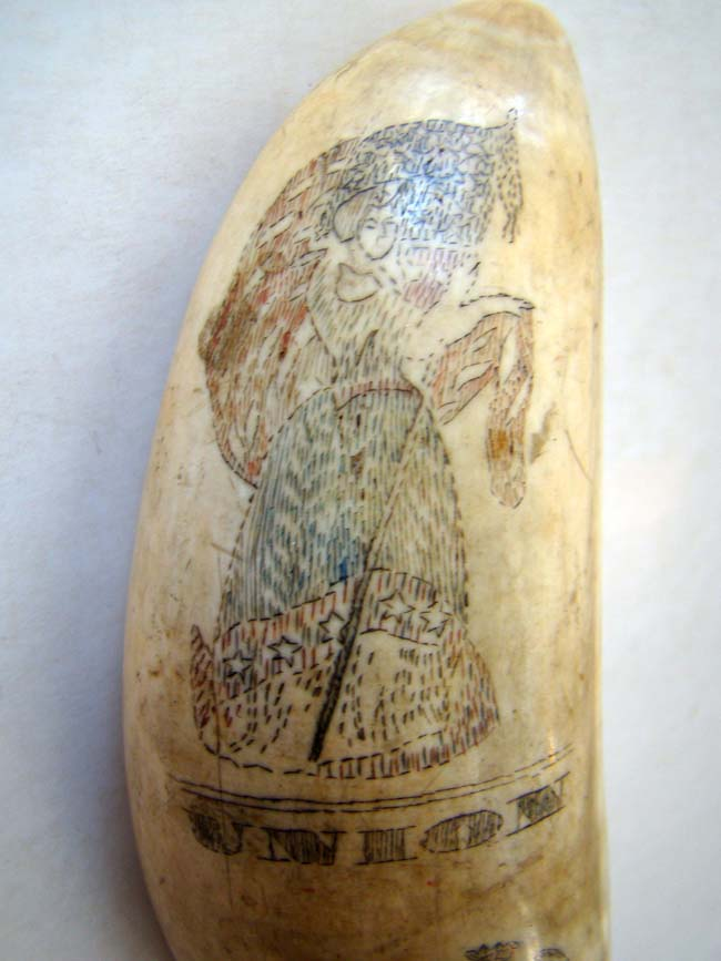 click to view larger image of A 19th century scrimshawed polycome decorated whale's tooth featuring LADY LIBERTY, UNION and a family or regimental crest circa 1860.