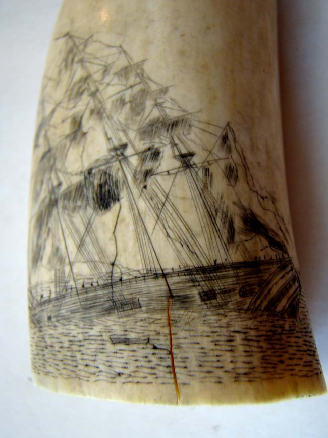 click to view larger image of A 19th century scrimshawed whale's tooth featuring a ship listing or floundering