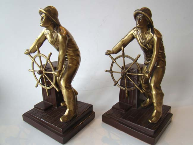 click to view larger image of A fabulous pair of bronze and brass finished Gloucester Fisherman bookends