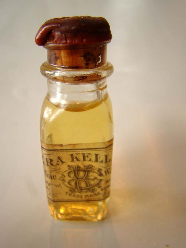 click to view larger image of A fine and rare unopened bottle of whale oil circa 1875 distributed by Ezra Kelley (1798-1895) of New Bedford, Mass.