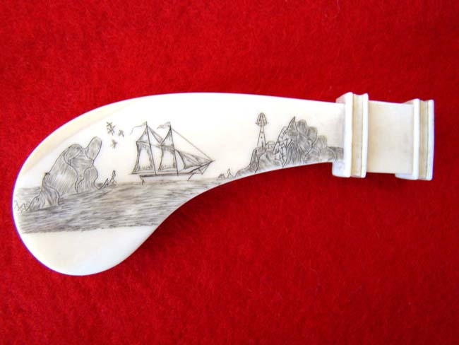 click to view larger image of A 19th century sailor-made scrimshawed whale ivory pie crimper handle