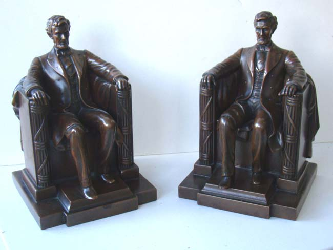 click to view larger image of A fine pair of  'Lincoln in the chair' bookends by Jennings Brothers circa 1925
