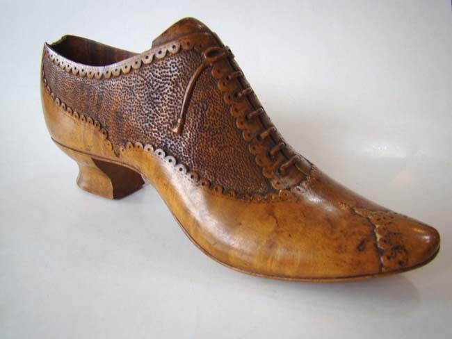 click to view larger image of A charming late 19th century carved wooden ladies shoe circa 1890