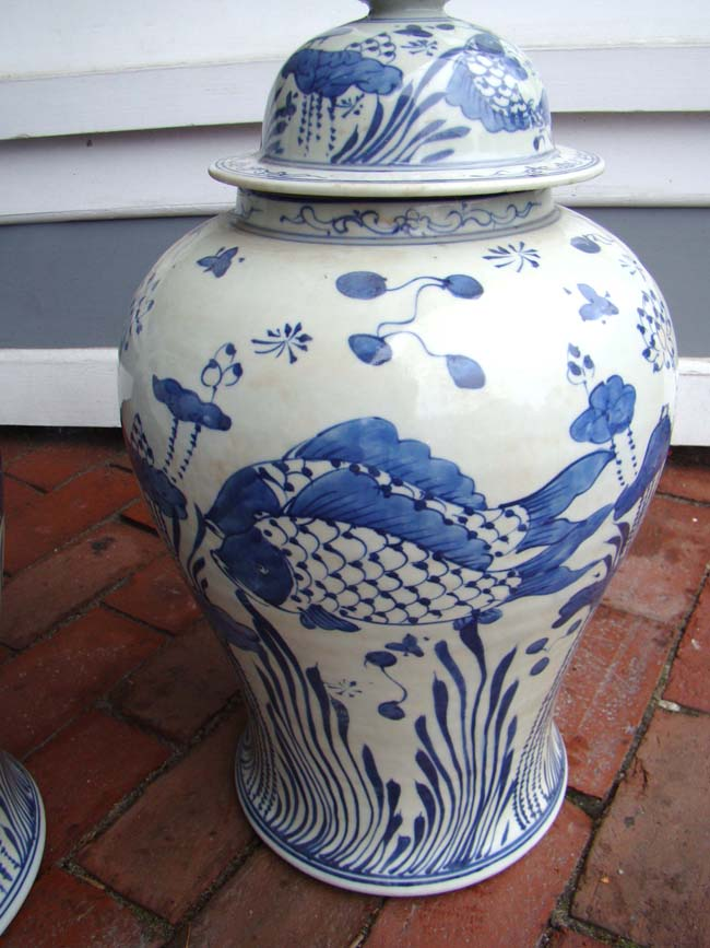 click to view larger image of An attractive pair of    Chinese Temple Jars in Koi fish motif, 20th century