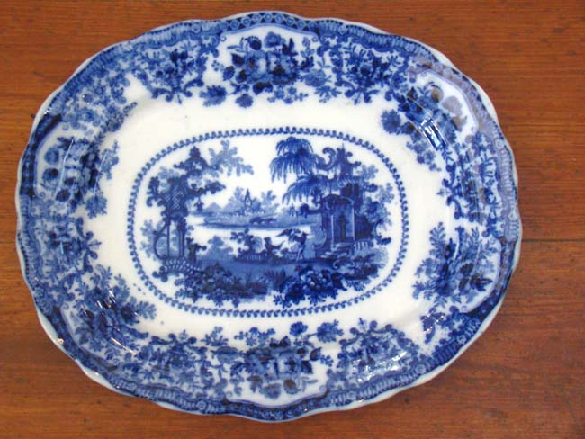 click to view larger image of A fine and rare early 19th century Flow Blue serving platter in the