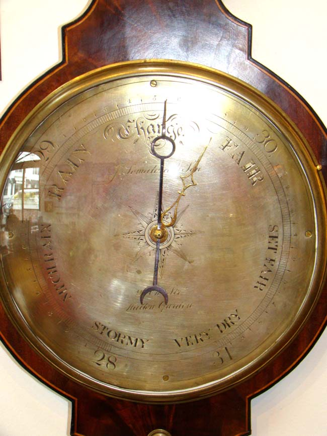 click to view larger image of A fine English mahogany wheel barometer with 10