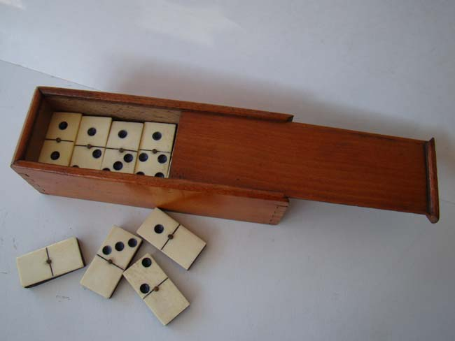 click to view larger image of A fine and complete boxed set of Civil War era bone and ebony dominoes circa 1860-1870