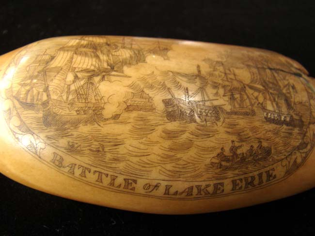 click to view larger image of A beautiful late 19th/early 20th century scrimshawed whale's tooth with War of 1812 Battle of Lake Erie.