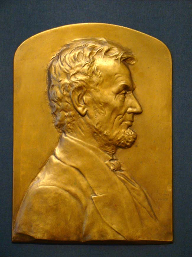 click to view larger image of A beautiful vintage bronze plaque depicting Abraham Lincoln sculpted by Luini Costanzo circa 1920