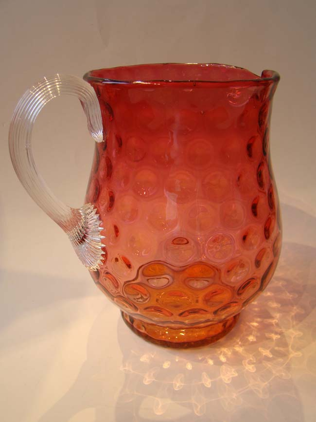 click to view larger image of An attractive vintage cranberry glass 'thumbprint' pattern pitcher
