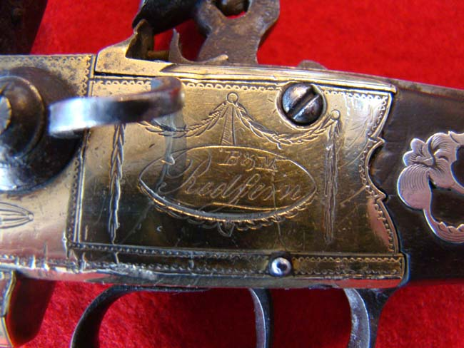 click to view larger image of A fine late 18th century English tap action over/under brass barreled flintlock pistol
