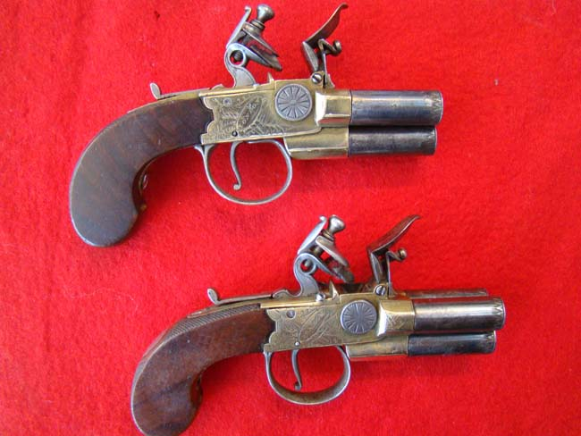 click to view larger image of A RARE pair of late 18th century English three-barrel flintlock tap action pocket pistols by Smith circa 1790.