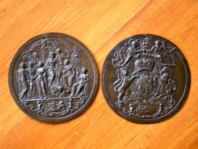 click to view larger image of A fine and rare pair of historically important Queen Anne period cast bronze medallions dated 1707.