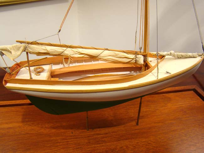 click to view larger image of A scratch built model of a Herreshoff 12 1/2 circa 1900 in a 1:24 scale built by Cape Cod modeler Tom Lauria