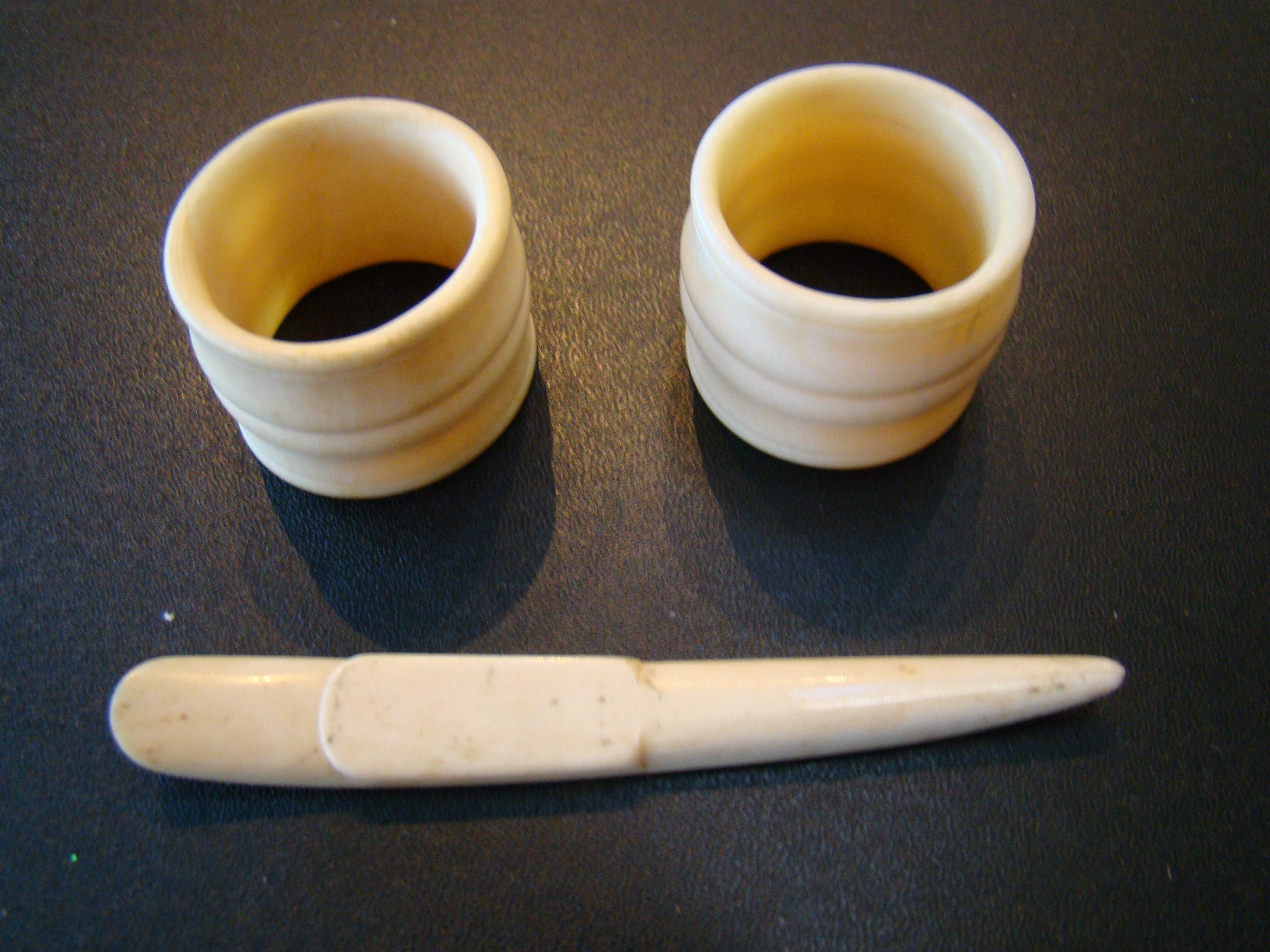 click to view larger image of A pair of 19th century whalebone napkin rings together with a small whalebone implement