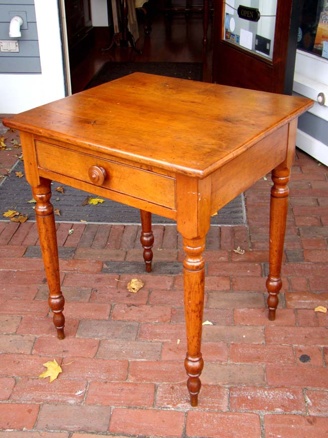 click to view larger image of An antique Cherry one-drawer nightstand-work table circa 1850