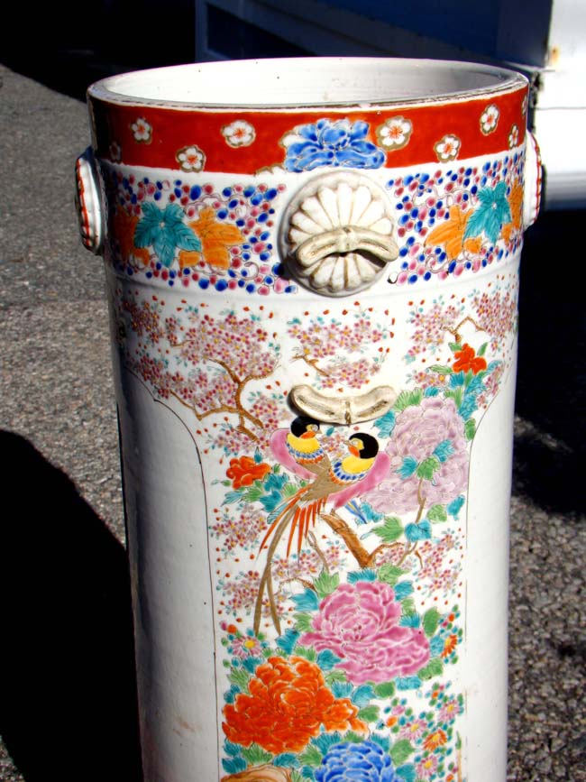 click to view larger image of A late 19th century Japanese polycrome porcelain umbrella stand