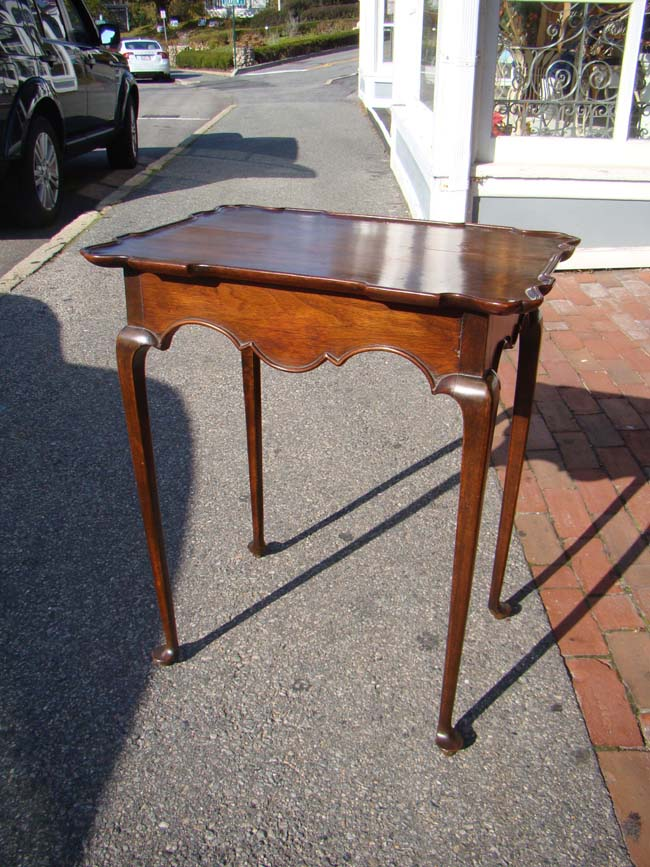 click to view larger image of An American Queen Anne 'style' diminutive mahogany tea table, 19th century