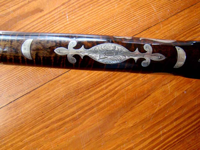 click to view larger image of A fine silver inlaid curly maple Pennsylvania percussion long rifle by Joseph Douglass of Huntington county circa 1850-1860.