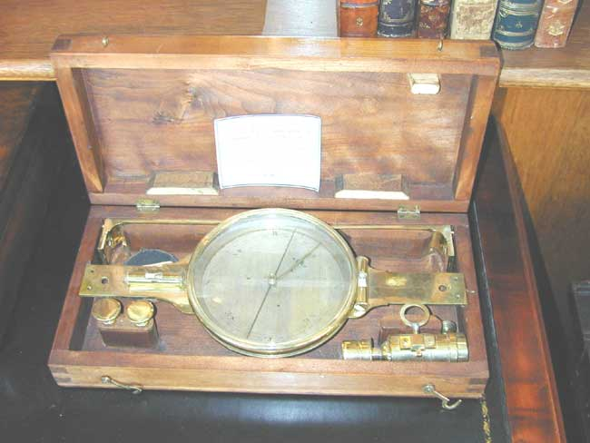 click to view larger image of An early 19th Century English Cased Surveyor's Compass.