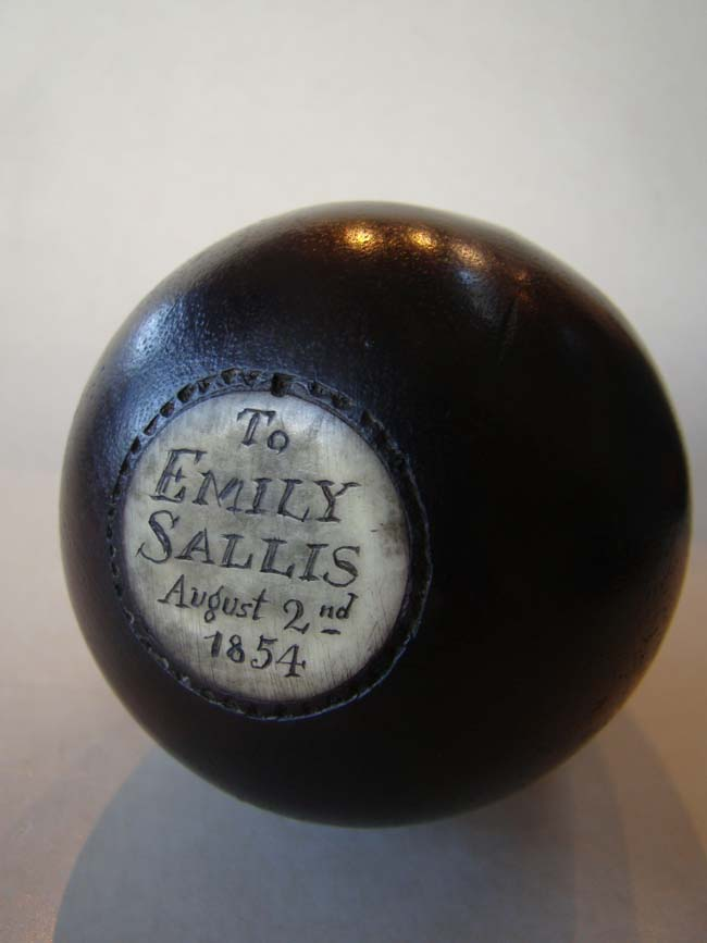click to view larger image of A 19th century sailor-made bone inlaid wooden games egg dated 1854