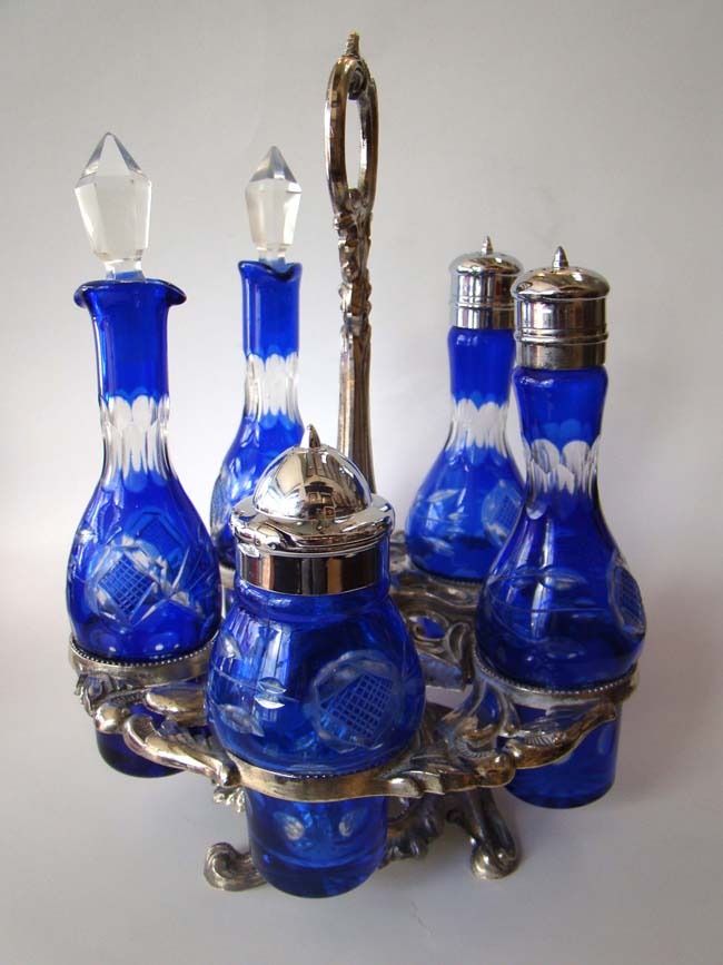 click to view larger image of A fabulous vintage cruet set with five cobalt blue etched glass bottles on a silver plated stand.