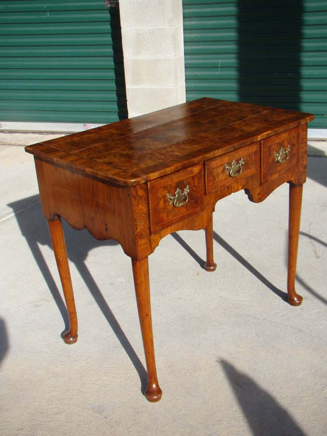 click to view larger image of An English Queen Anne period walnut veneered dressing table circa 1710