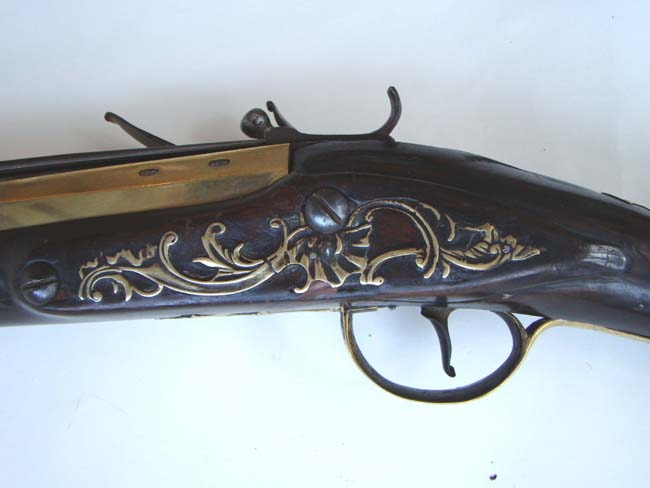 click to view larger image of An English Revolutionary War period blunderbuss with spring mounted bayonet by Joseph Heylin of London circa 1775-1780.