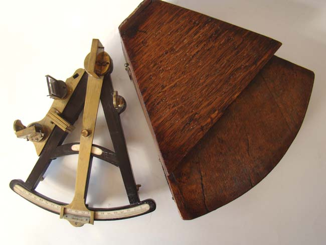 click to view larger image of A diminutive ebony framed mariner's octant circa 1815-1835 possibly used aboard the Trident, a whaling ship from New Bedford.