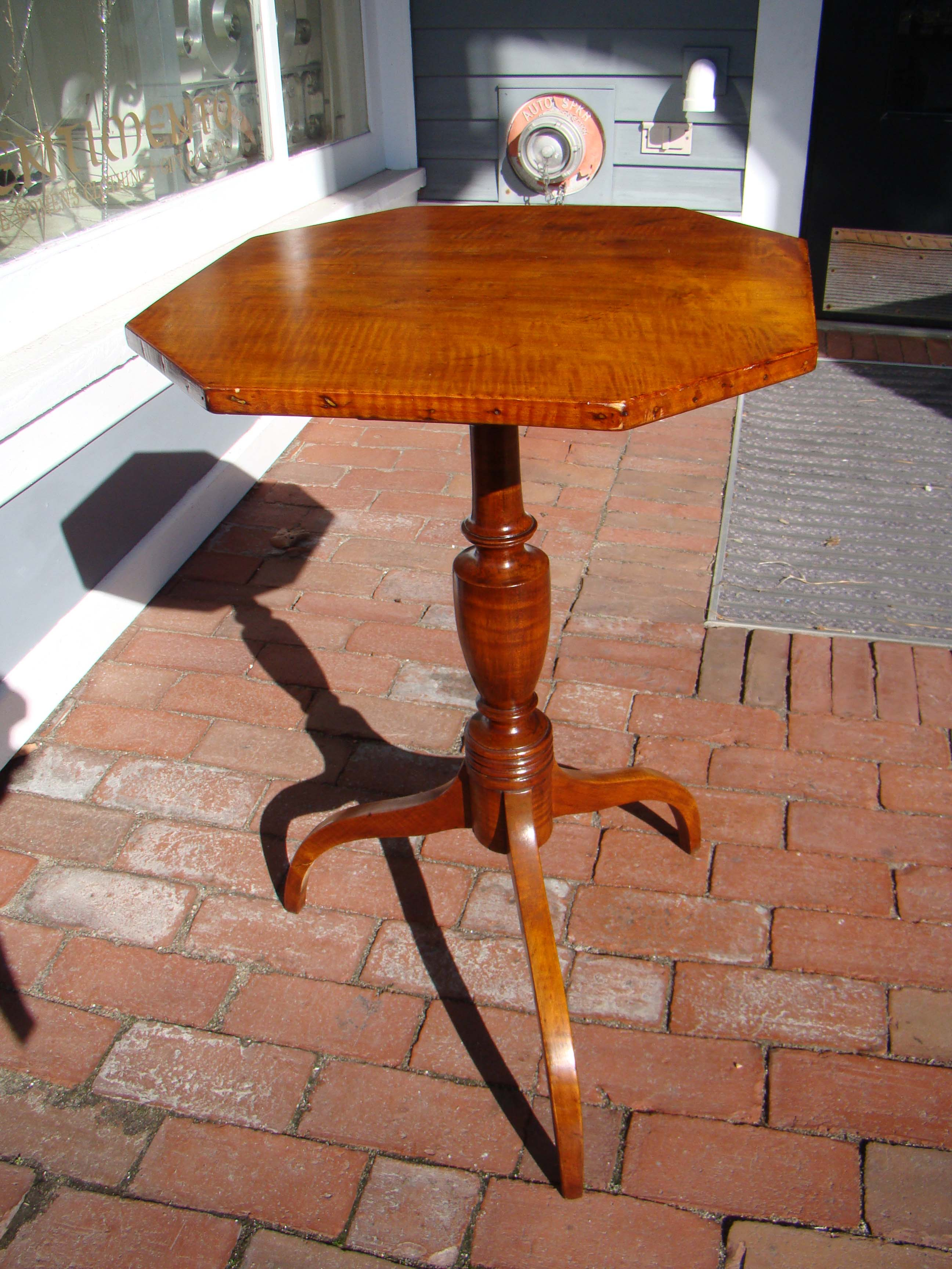 click to view larger image of A beautiful early 19th century New England tiger maple candle stand with octagonal top circa 1810