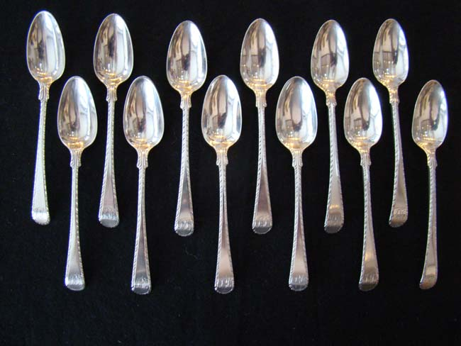 click to view larger image of An exceptionally fine and rare set of 12 English 18th century sterling silver teaspoons circa 1775-1785