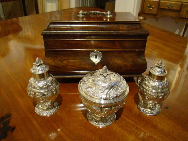 click to view larger image of A Magnificent 18th century Mahogany Bombe form Tea Caddy Box with its' original sterling silver cannisters by Francis Crump, London, 1757.