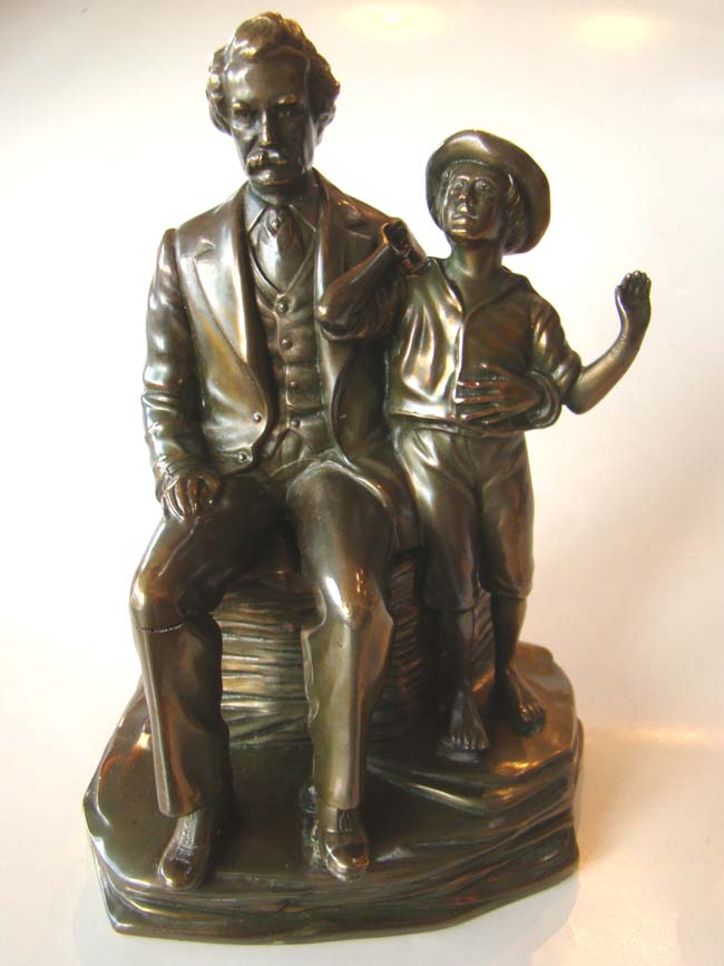 click to view larger image of An extremely rare pair of vintage Mark Twain and Tom Sawyer bookends by Jennings Brothers circa 1936