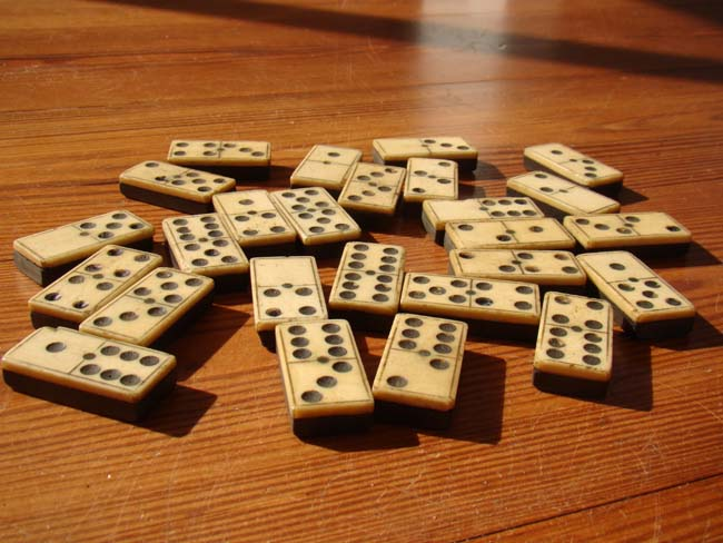click to view larger image of A set of 26 antique 19th century bone and ebony dominoes