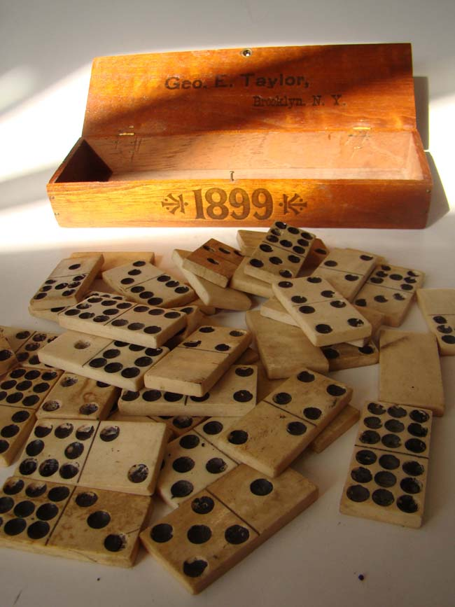 click to view larger image of A set of 36 antique 19th century solid bone dominoes in a box inscribed