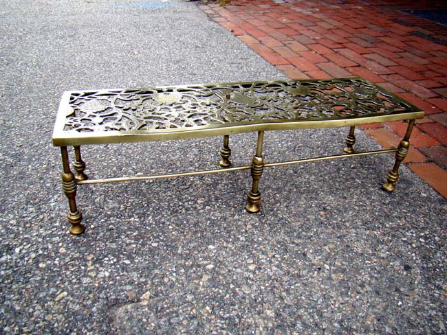 click to view larger image of A fine all brass Victorian fireplace trivet circa 1860-1890 in the beehive and grape vine pattern