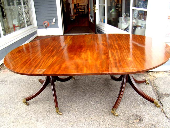 click to view larger image of A gorgeous English Regency period (circa 1810-1820) two pedestal mahogany dining table