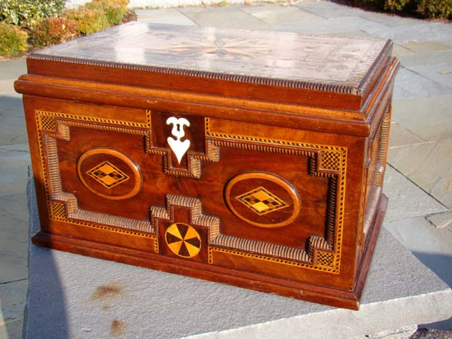 click to view larger image of A FABULOUS 19th century British sailor-made walnut chest with applied moldings, fruitwood inlays and a whalebone keyhole escutcheon circa 1865-1880.