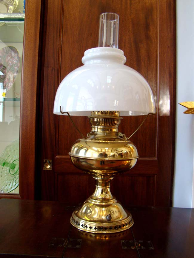 click to view larger image of A 19th century oil lamp by RAYO, converted to electricity