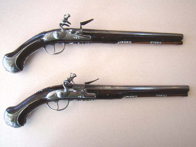 click to view larger image of A large and impressive pair of French Holster pistols circa 1685