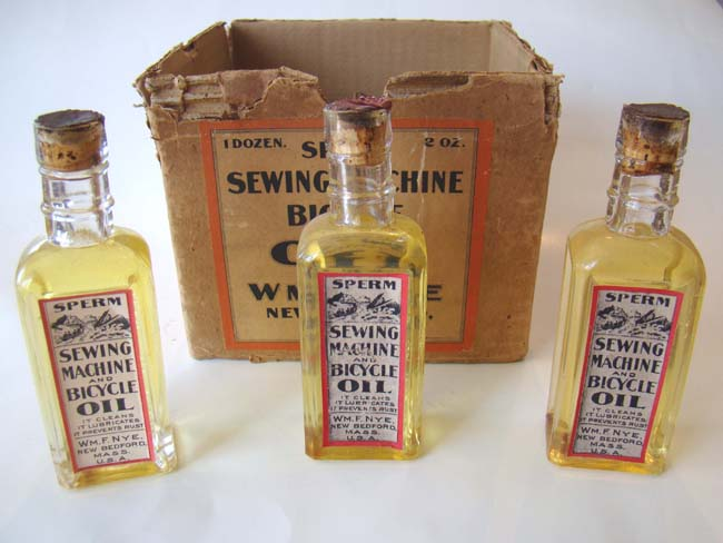 click to view larger image of Three unopened bottles of Nye Sperm Whale Oil in the original cardboard box circa 1890