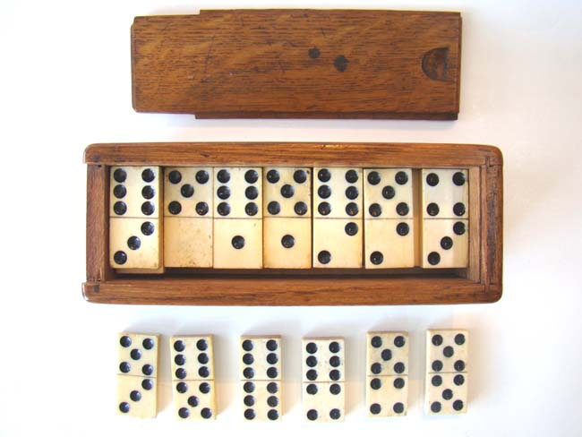 click to view larger image of A fine set of solid bone antique 19th century dominoes in the original box