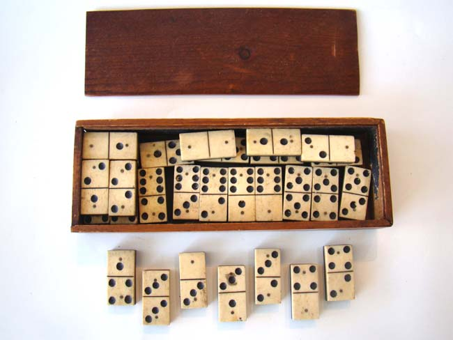 click to view larger image of A complete set of Civil War era (circa 1865) bone and ebony dominoes.