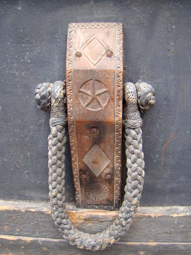click to view larger image of A 19th century sailor-made lift-top seachest circa 1840 with fabulous carved cleats and rope beckets